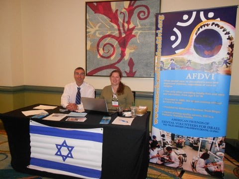 Michelle Levin and Dr. Roy Petel - DVI booth at AAPD