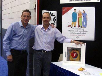 Mr John Alibrandi and Dr Moti Moskivitz with the donated HeartSine Samaritan AED