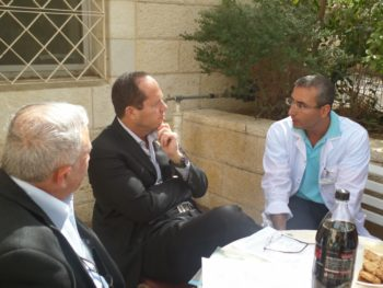 Mayor Barkat with Dr. Roy Petel discussing DVI